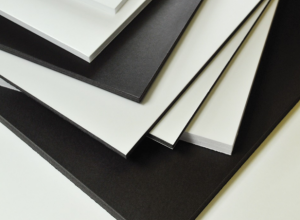 stack of white and black foam board
