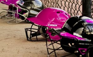 black and pink baseball helmets
