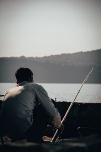 a man in white shirt fishing