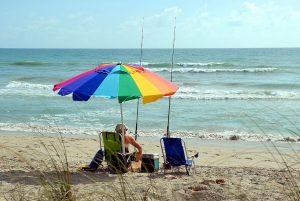 fisherman under a beach umbrella