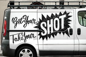 White van with a decal