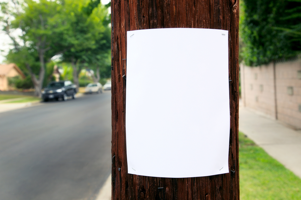 bandit sign on telephone pole