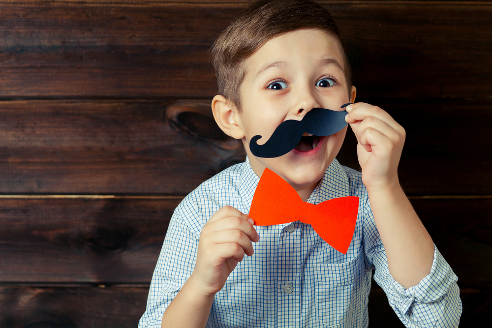 Little boy with mustache booth props