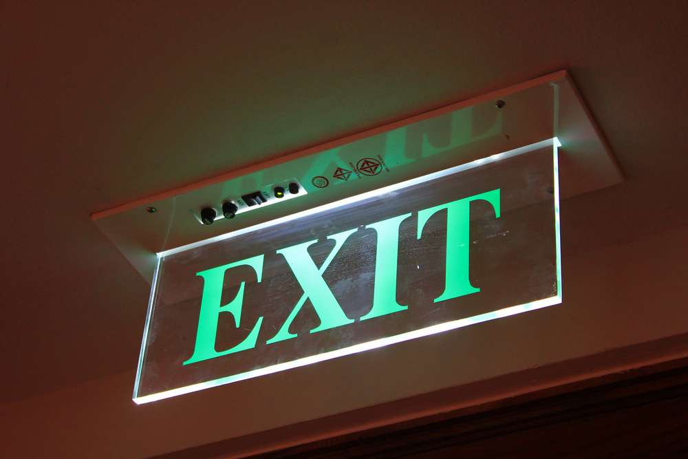 lit green exit acrylic sign