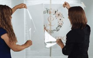 women installing decals